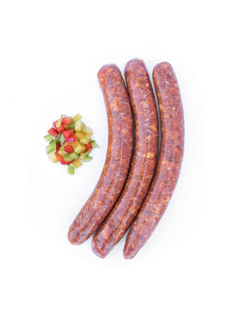 La piquante, saucisse au piment d'Espelette. Maison Alpin. Vente en direct de la salaison familiale. Charcuterie artisanale, saucisson, saucisse, diot, jambon, de Haute-Savoie & viande de qualité supérieure en ligne.
